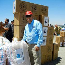 Elder Jim Anderson delivers hygiene kits for distribution at camps for Syrian refugees in Jordan.
