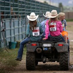 Participants ride on the back of an all-terrain vehicle between sessions of the Utah High School Rodeo Finals at the Wasatch County Events Complex in Heber City on Thursday, June 1, 2017.
