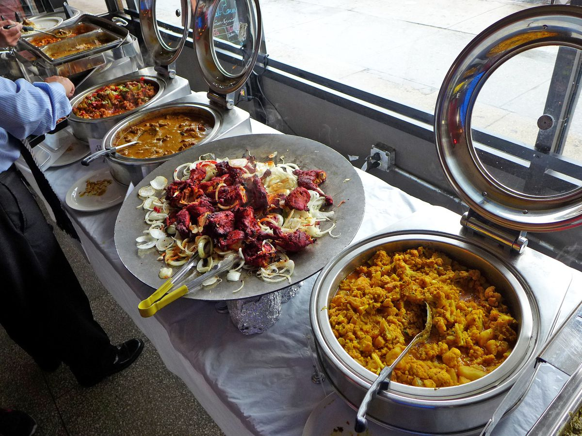 Several receptacles filled with curries in the front window of Jackson Diner
