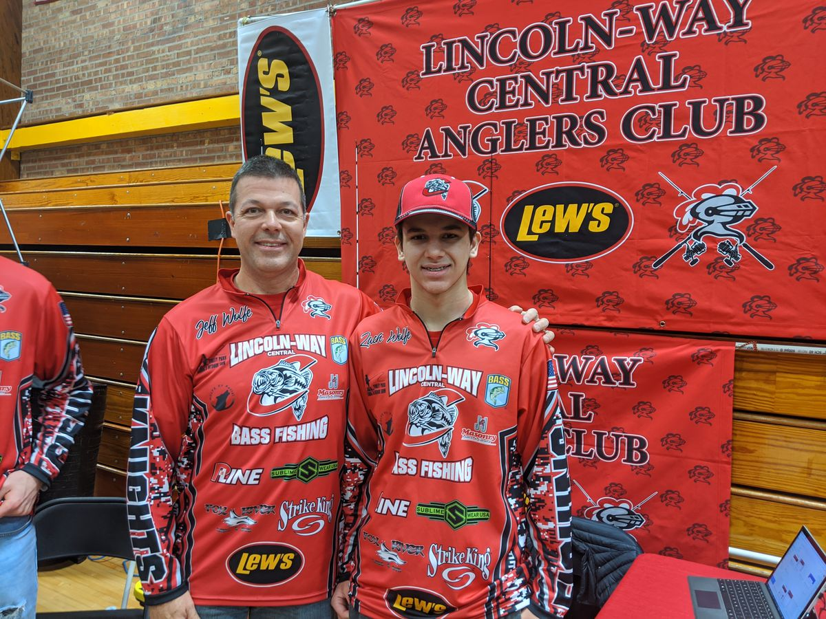 Lincoln-Way Central Anglers Club coach Jeff Wolfe and his freshman son Zach fundraising in February at the Tinley Park Fishing Show. Credit: Dale Bowman