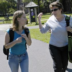 Emma Ferguson, 50, right, is shown on campus at Mount Holyoke College in South Hadley, Mass., Thursday, Sept. 7, 2006, as she walks to a class with fellow student Jennifer Richardson, 19, of Boston.
