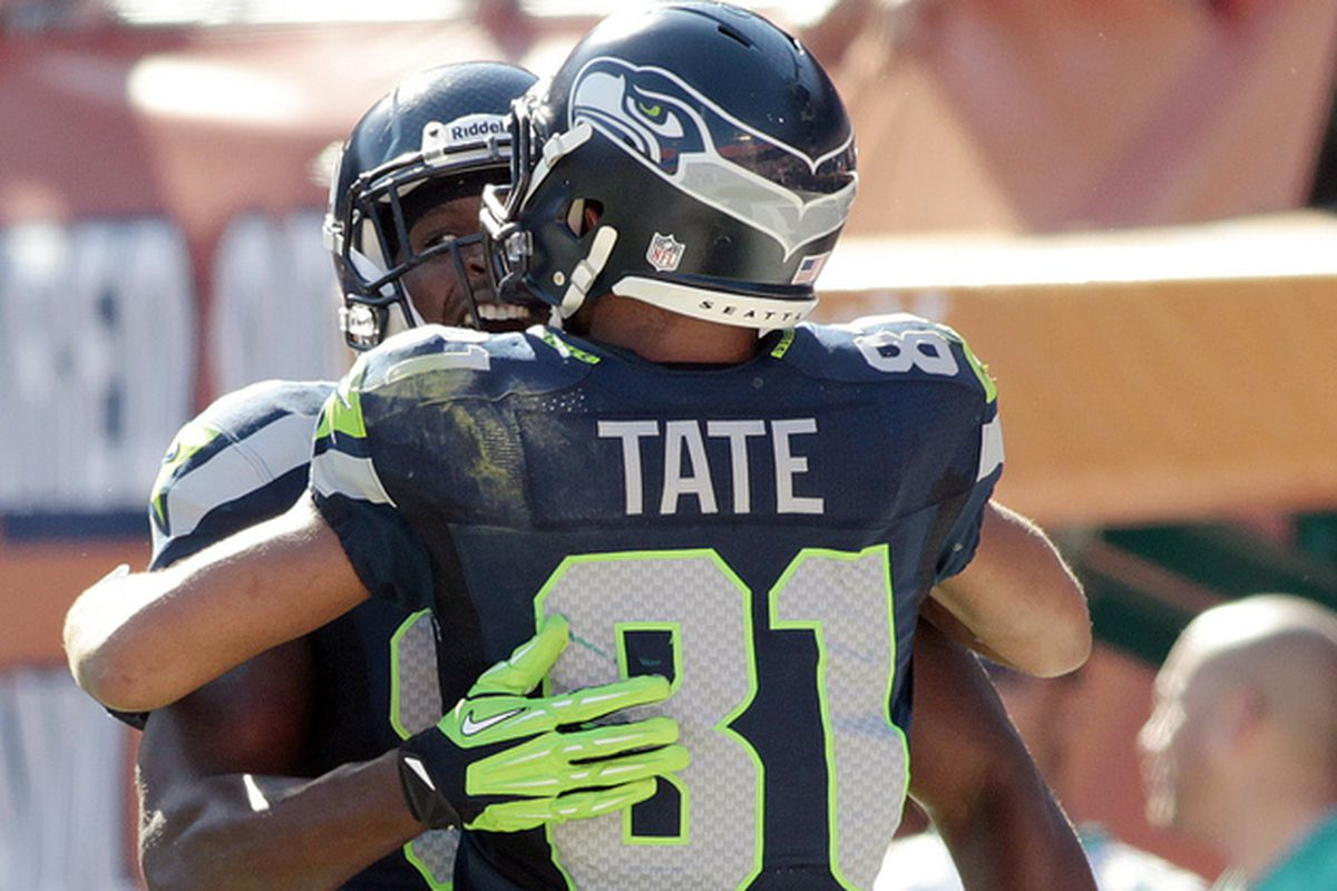 NOV 25, 2012; Miami, FL, USA; Seattle Seahawks tight end Anthony McCoy (85) celebrates his touchdown catch with Seattle Seahawks wide receiver Golden Tate (81) against the Miami Dolphins in the second quarter at Sun Life Stadium.