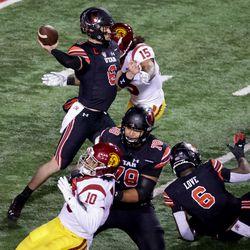Utah Utes quarterback Jake Bentley (8) passes under pressure from USC Trojans safety Talanoa Hufanga (15) at Rice-Eccles Stadium in Salt Lake City on Saturday, Nov. 21, 2020.