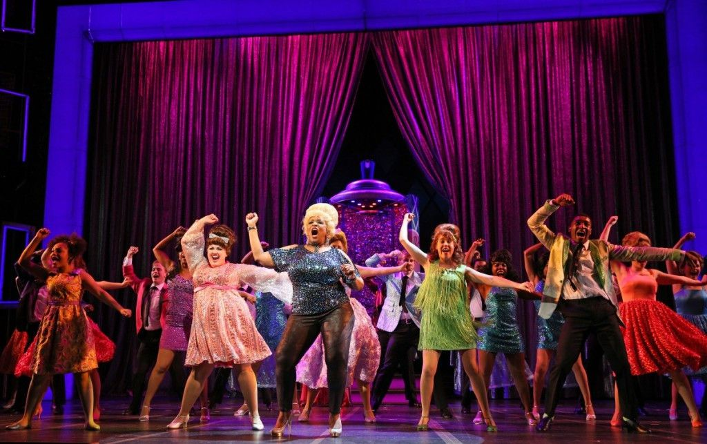 """The Paramount Theatre cast of """"Hairspray, """" led by Amelia Jo Parish (left) as Tracy Turnblad, E. Faye Butler as Motomouth Maybelle and Landree Fleming as Penny Pingleton. (Photo: Liz Lauren)"""
