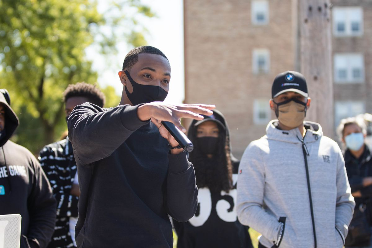 Rapper G Herbo speaks Saturday outside Overton Elementary School in Bronzeville during the Peace Walk & Community Give-Back Celebration.