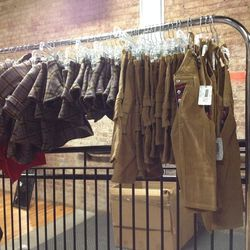 There are two racks of tiny, adorable clothing for children. It's mostly price between $20 and $30.