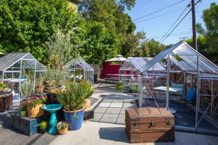 Outdoor greenhouse dining area at Lady Byrd Cafe in Echo Park, California