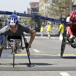 Women's wheelchair winner Shirley Reilly of the United States, left, crosses  the finish line ahead of second-place finisher Wakako Tsuchida of Japan in the 2012 Boston Marathon in Boston, Monday, April 16, 2012.