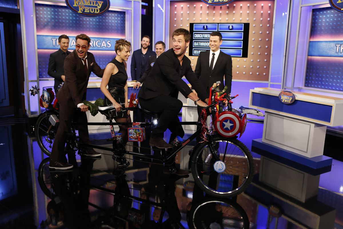 Chris Hemsworth and Robert Downey Jr. riding a tandem bike on the set of Jimmy Kimmel Live during the Avengers: Age of Ultron press tour.