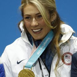 Gold medalist in the women's giant slalom Mikaela Shiffrin, of the United States, smiles during the medals ceremony at the 2018 Winter Olympics in Pyeongchang, South Korea, Thursday, Feb. 15, 2018.