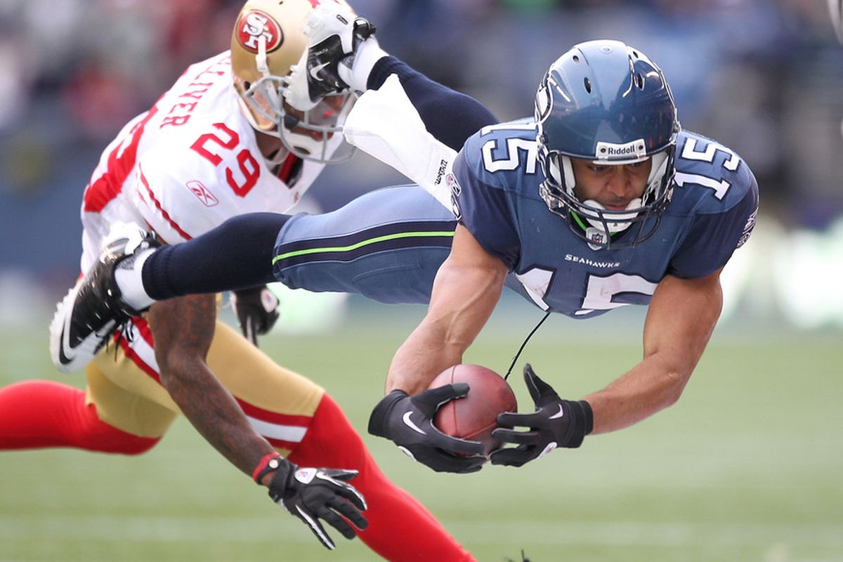 SEATTLE - DECEMBER 24:  Wide receiver Doug Baldwin #15 of the Seattle Seahawks rushes against Chris Culliver #29 of the San Francisco 49ers at CenturyLink Field on December 24, 2011 in Seattle, Washington. (Photo by Otto Greule Jr/Getty Images)