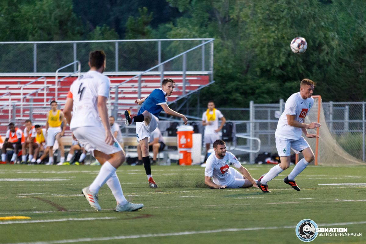 July 16, 2019 - St. Louis Park, Minnesota, United States - Minneapolis City SC midfielder Nick Hutton (14) scores a goal off a deflected shot during the NPSL North playoff match against Med City FC at Benilde-St. Margaret's.