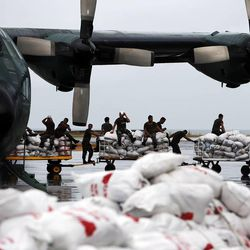 Relief supplies are unloaded in Tacloban, Friday, Nov. 22, 2013.