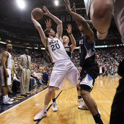 Gordon Hayward of the Utah Jazz handles the ball and is pressured in the last minute of play against Minnesota during an NBA basketball game in Salt Lake City, Friday, April 12, 2013.
