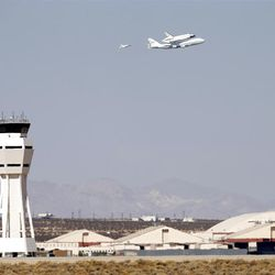 Space Shuttle Endeavour, top, mounted on NASA's Shuttle Carrier Aircraft (SCA) flies over Edwards Air Force Base, Calif., Thursday, Sept. 20, 2012. (AP Photo/Jae C. Hong)