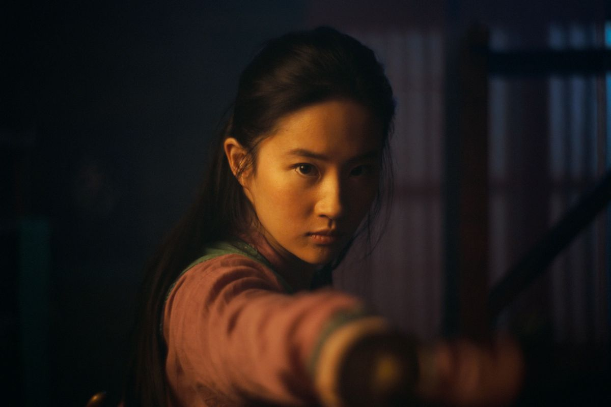"""This image released by Disney shows Yifei Liu in the title role of """"Mulan."""" The film is no longer headed for a major theatrical release. The Walt Disney Co. said Tuesday that it will debut its live-action blockbuster on its subscription streaming service, Disney Plus, on Sept. 4. Customers will have to pay an additional $29.99 on top of the cost of the monthly subscription to rent """"Mulan."""""""
