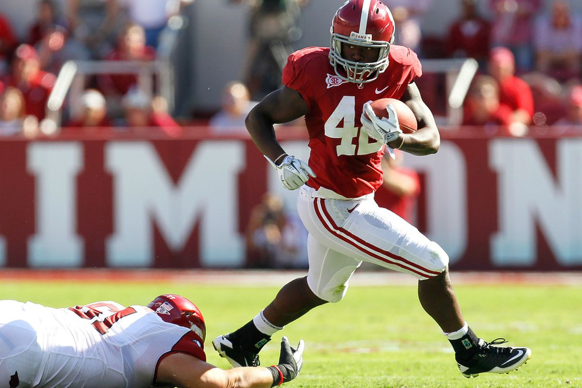 TUSCALOOSA, AL - SEPTEMBER 24:  Eddie Lacy #42 of the Alabama Crimson Tide breaks a tackle by Zach Stadther #61 of the Arkansas Razorbacks at Bryant-Denny Stadium on September 24, 2011 in Tuscaloosa, Alabama.  (Photo by Kevin C. Cox/Getty Images)