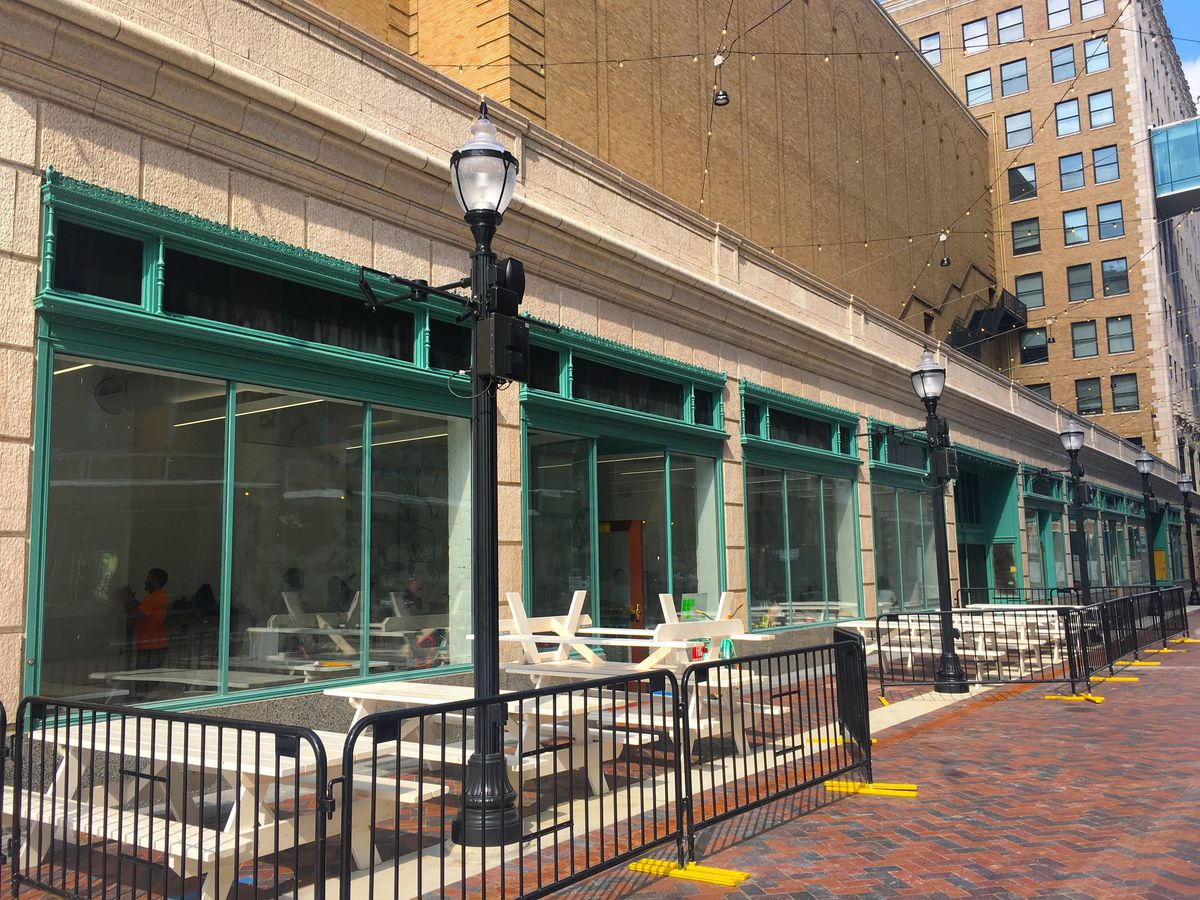 Pale green metal frames surround the large windows at Frita Batidos, under construction on Columbia Street.