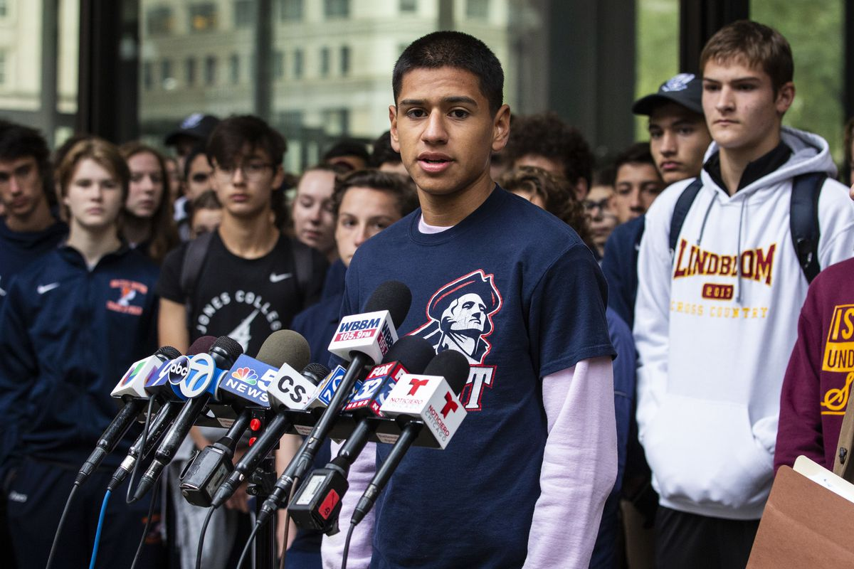 Flanked by dozens of students, Angel Arismendiz, a senior at Washington who plays soccer, speaks during a press conference outside the Daley Center.