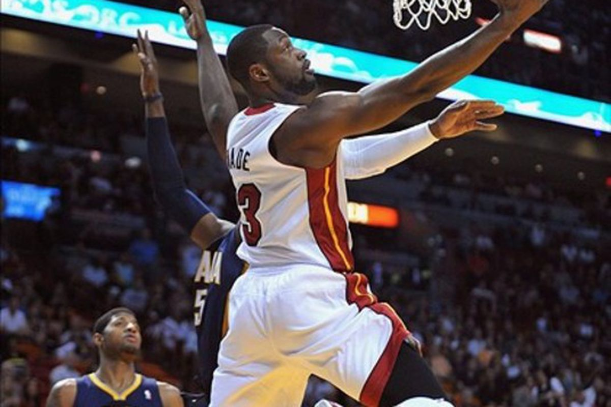 March 10, 2012; Miami, FL, USA; Miami Heat shooting guard Dwyane Wade (3) scores against the Indiana Pacers during the first half at American Airlines Arena. Mandatory Credit: Steve Mitchell-US PRESSWIRE