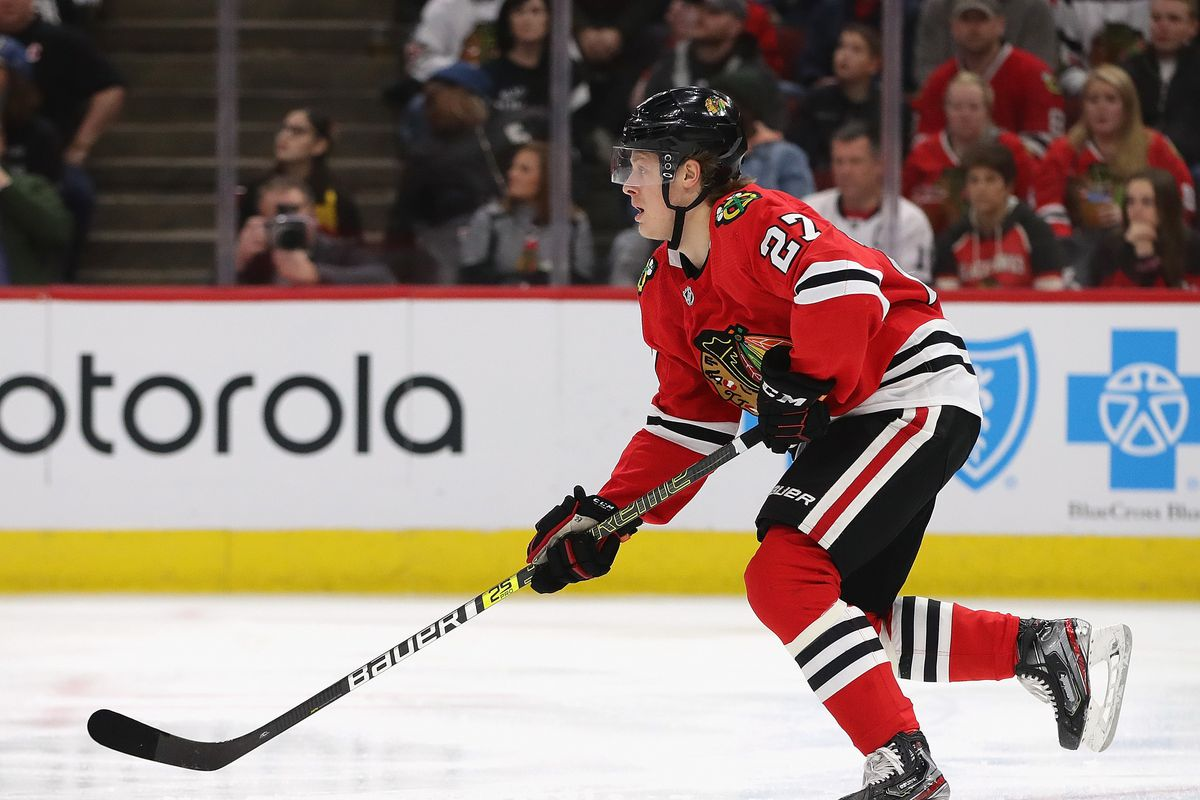 Adam Boqvist of the Chicago Blackhawks advances the puck against the New Jersey Devils at the United Center in December.