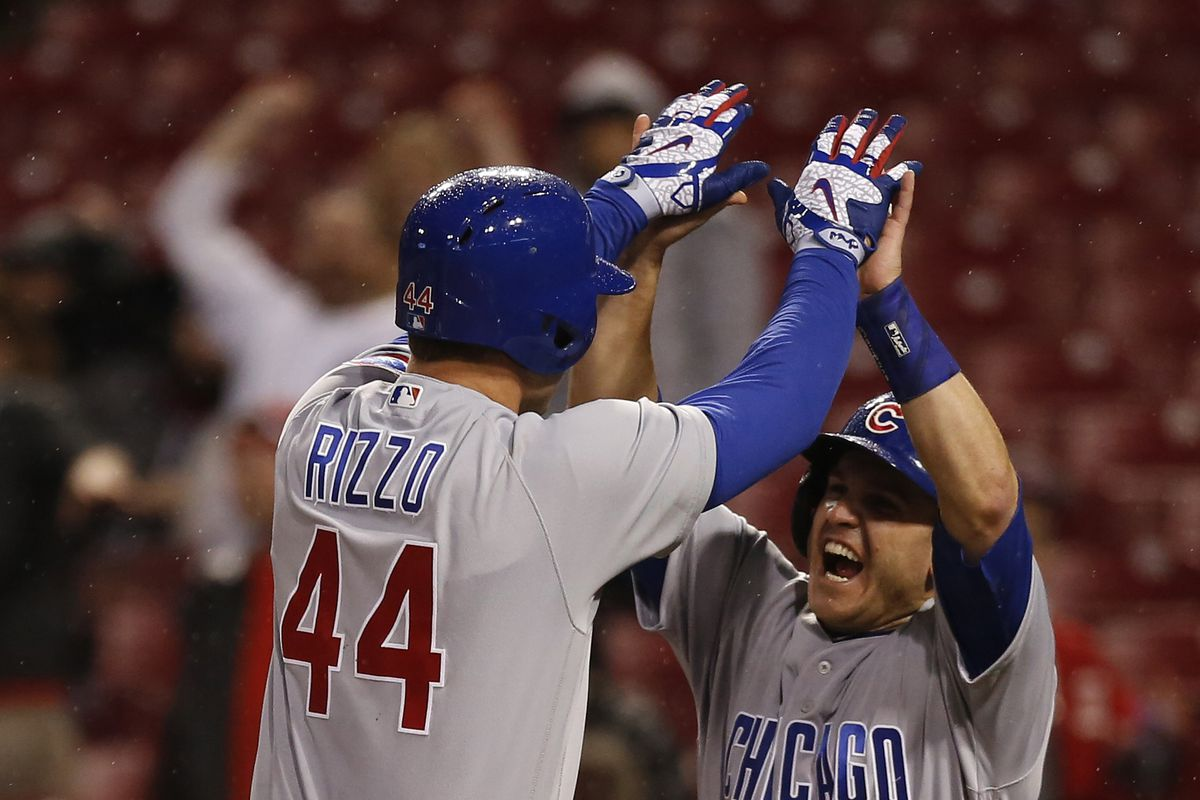 Apr 21, 2017; Cincinnati, OH, USA; Chicago Cubs first baseman Anthony Rizzo (44) reacts with pinch hitter Miguel Montero (47) after Rizzo hit a three run home run against the Cincinnati Reds during the ninth inning at Great American Ball Park. The Cubs won 6-5. Mandatory Credit: David Kohl-USA TODAY Sports