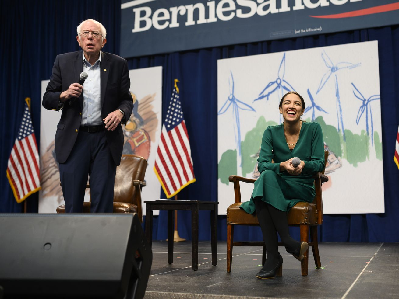 Democratic presidential candidate Sen. Bernie Sanders (I-VT) and US Rep. Alexandria Ocasio-Cortez (D-NY) field questions from audience members at the Climate Crisis Summit at Drake University on November 9, 2019, in Des Moines, Iowa.