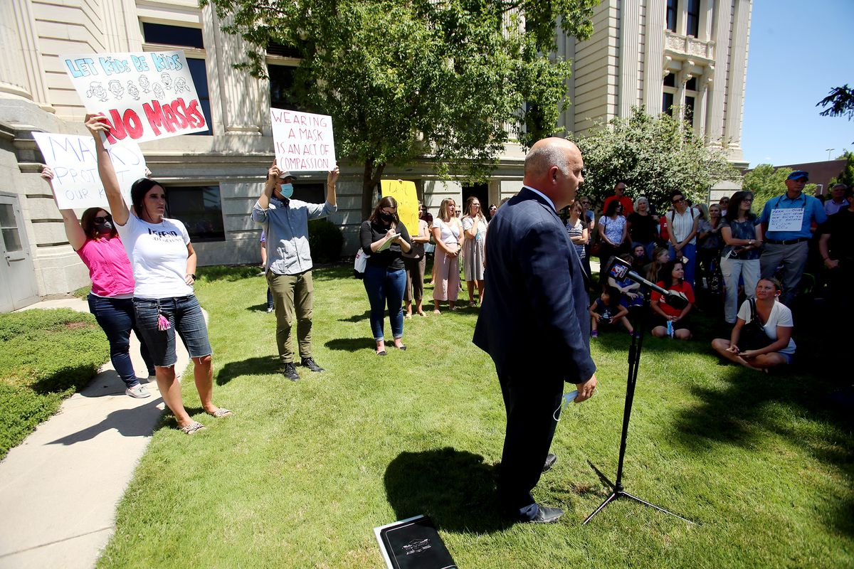 """Utah County Commissioner Bill Lee speaks with residents prior Utah County Commission meeting in Provo on Wednesday, July 15, 2020. The commission was scheduled to vote on a letter asking Ralph Clegg, executive director of the Utah County Health Department, to give Utah County """"compassionate exemptions"""" to Gov. Gary Herbert's mask mandate for K-12 schools. However, the meeting was cut short after Tanner Ainge, the commission's chairman, made a motion to continue the meeting at a later date, saying it violated several public health directives issued by the state and county. The motion to reschedule passed 2-1, bringing boos from protesters."""