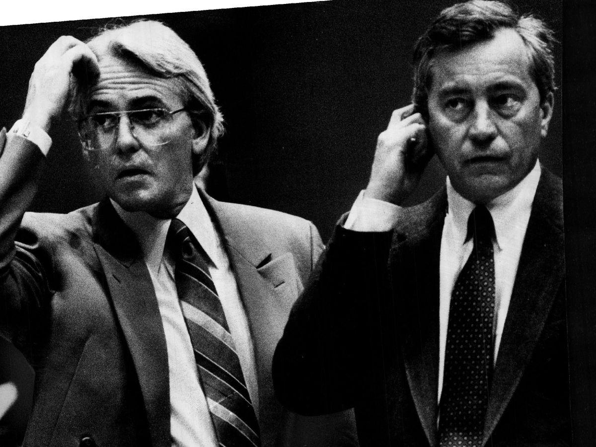 Aldermen Edward Burke (left) and Edward R. Vrdolyak confer during a Council debate on cable TV in Chicago in 1985. File Photo.