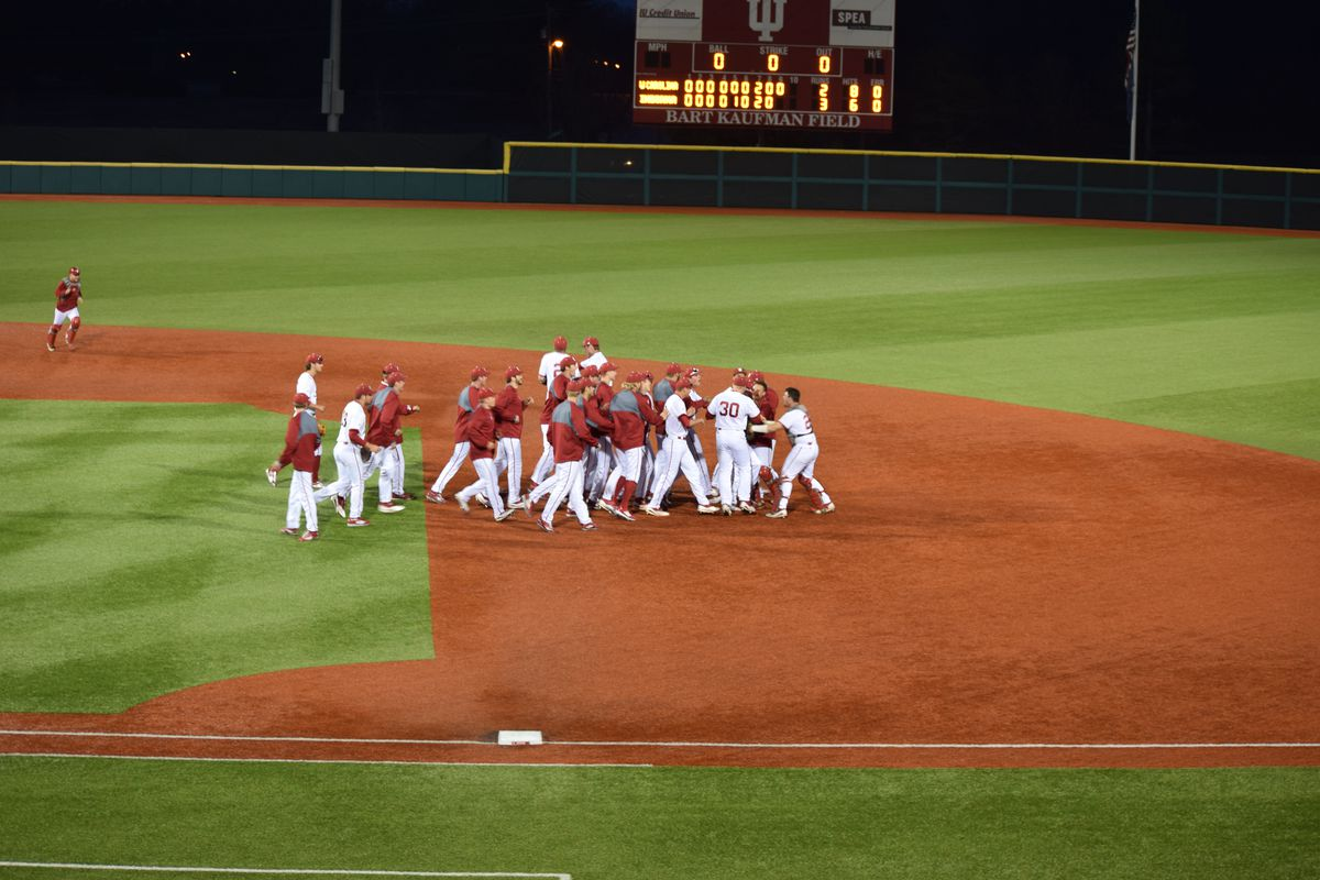 The Hoosiers celebrate Friday night's win after Luke Miller nailed the final out at the plate