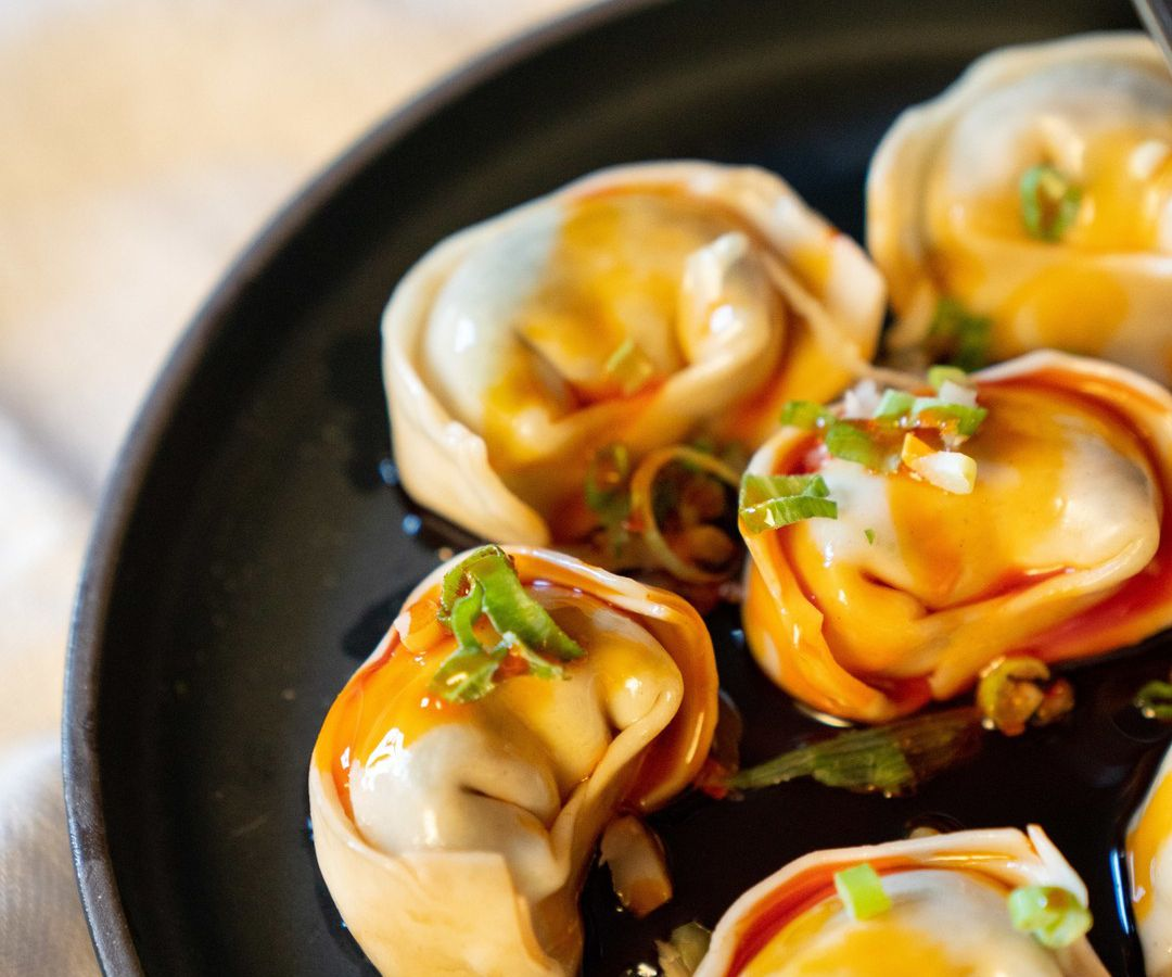 Red-oil pork wontons, available frozen