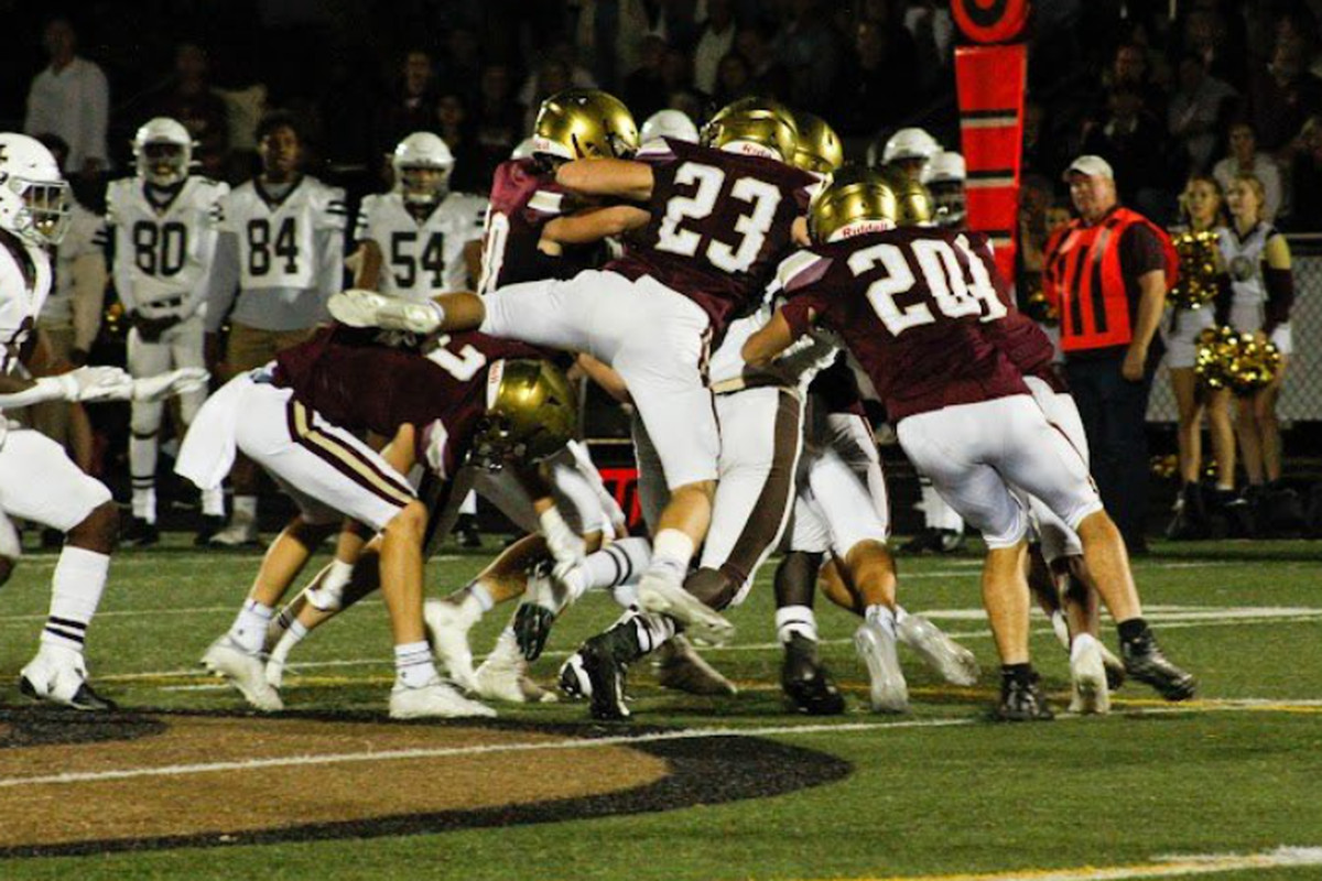 Vinny Rugai and his St. Ignatius teammates make a tackle in the win against Mount Carmel.