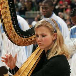 Utah Jazz hosting Los Angeles Clippers at Energy Solutions Arena. Elizabeth Smart plays the harp that accompanied the national anthem at the start of the game on December 26, 2006.