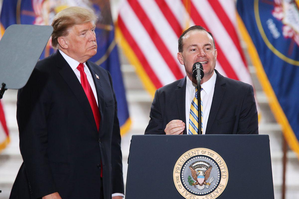 Sen. Mike Lee, R-Utah, speaks as President Donald Trump looks on at the Capitol in Salt Lake City on Monday, Dec. 4, 2017.