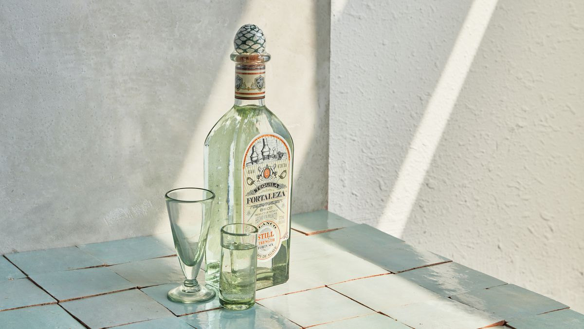 A bottle of tequila with a decorative cap