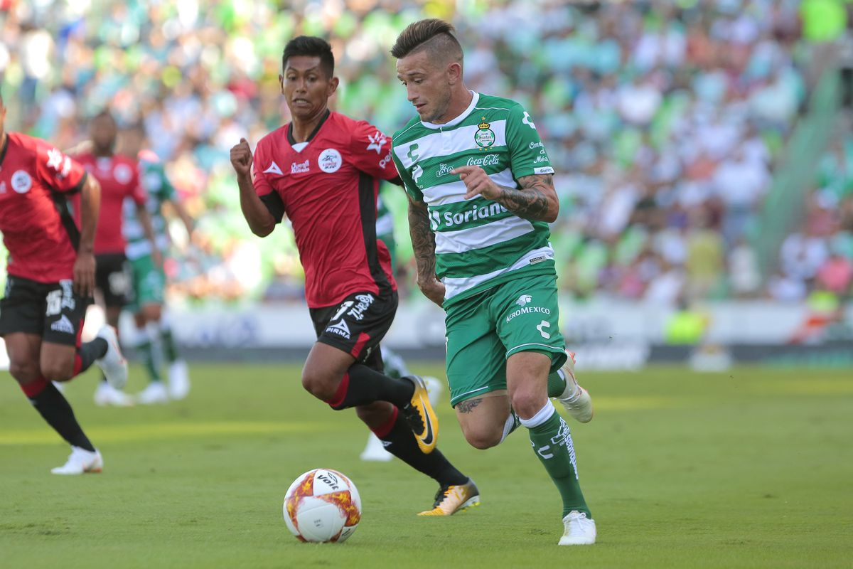 a67be528b Brian Lozano of Santos (R) dribbles the ball past Luis Olascoaga of Lobos  during the 1st round match as part of the Torneo Apertura 2018 Liga MX on  July 22