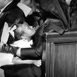 """During the funeral service for her husband, Coretta Scott King comforts her daughter Bernice, in this photo from the exhibit """"This Light of Ours,"""" running from Oct. 8 to March 31 at The Leonardo. Bob Fitch, Atlanta, 1968"""