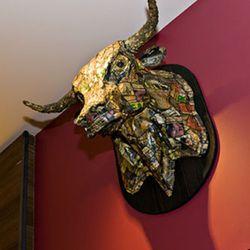 Two papier-mache bulls heads watch over the restaurant.