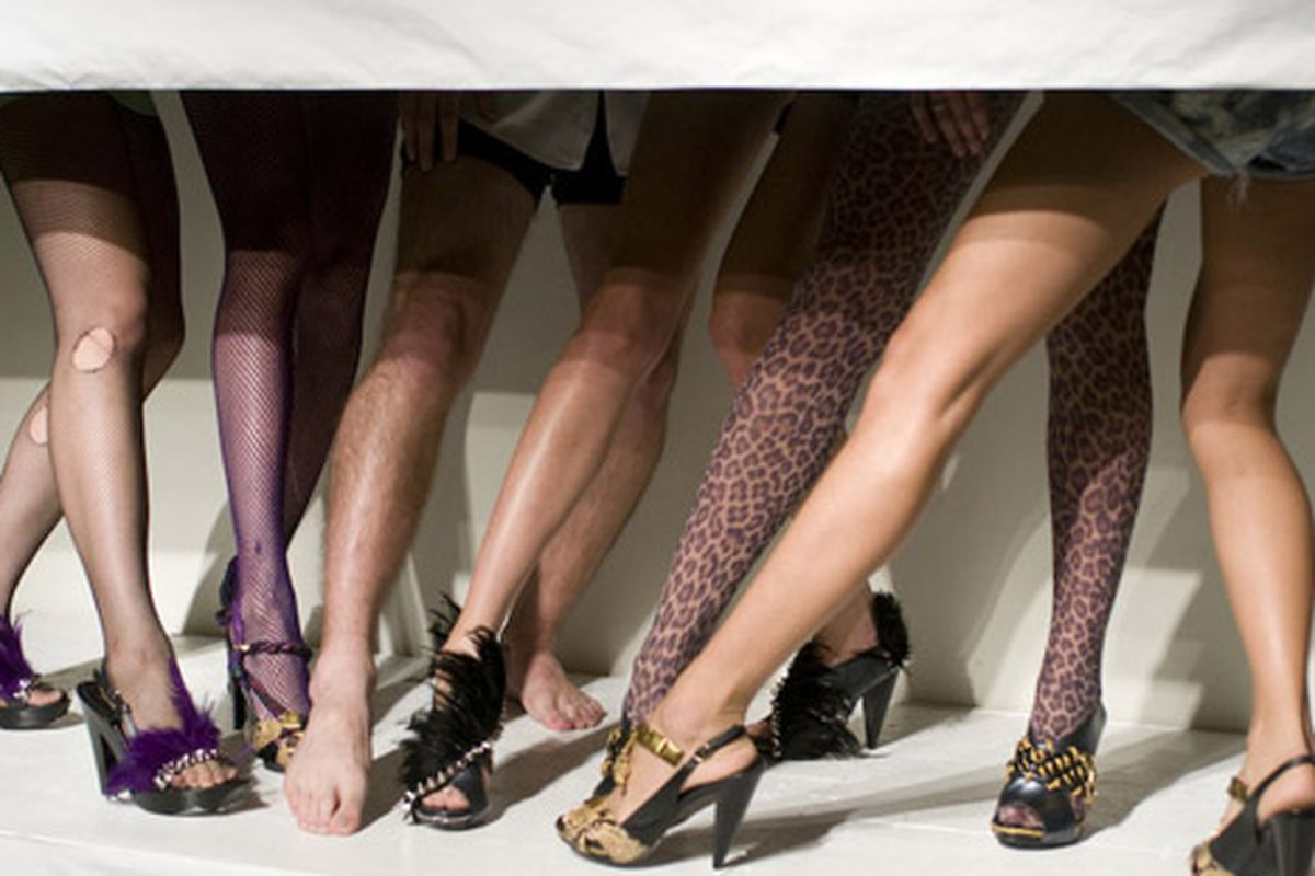 """Thanks, guy with the hairy legs, for ruining the fantasy. Image via <a href=""""http://blackburnandsweetzer.com/2009/10/12/la-fashion-week-shoe-show-km2-at-em-co/"""">Blackburn and Sweetzer</a>"""