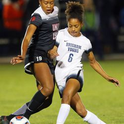 BYU Nadia Gomes (6) kicks the ball past UNLV Chidera Akubuilo (19) as BYU and UNLV play in the first round of the NCAA tournament in Provo on Friday, Nov. 11, 2016.