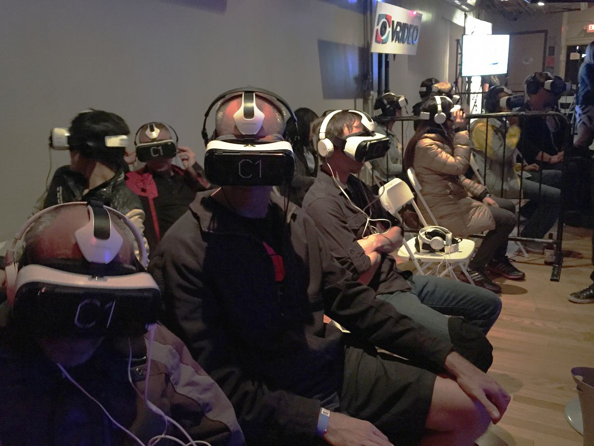 Attendees of the Kaleidoscope VR film festival watch videos on the Samsung Gear VR.