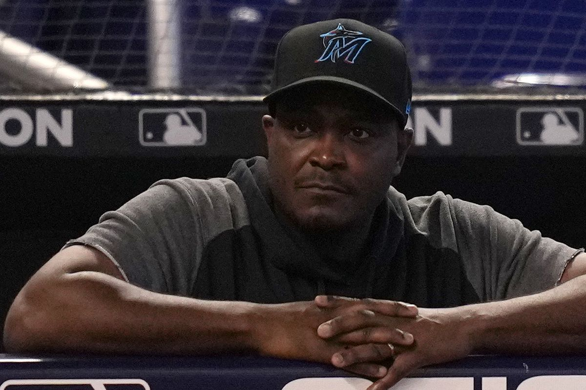 Miami Marlins interim manager James Rowson watches from the dugout in the game between the Miami Marlins and the New York Mets at loanDepot park