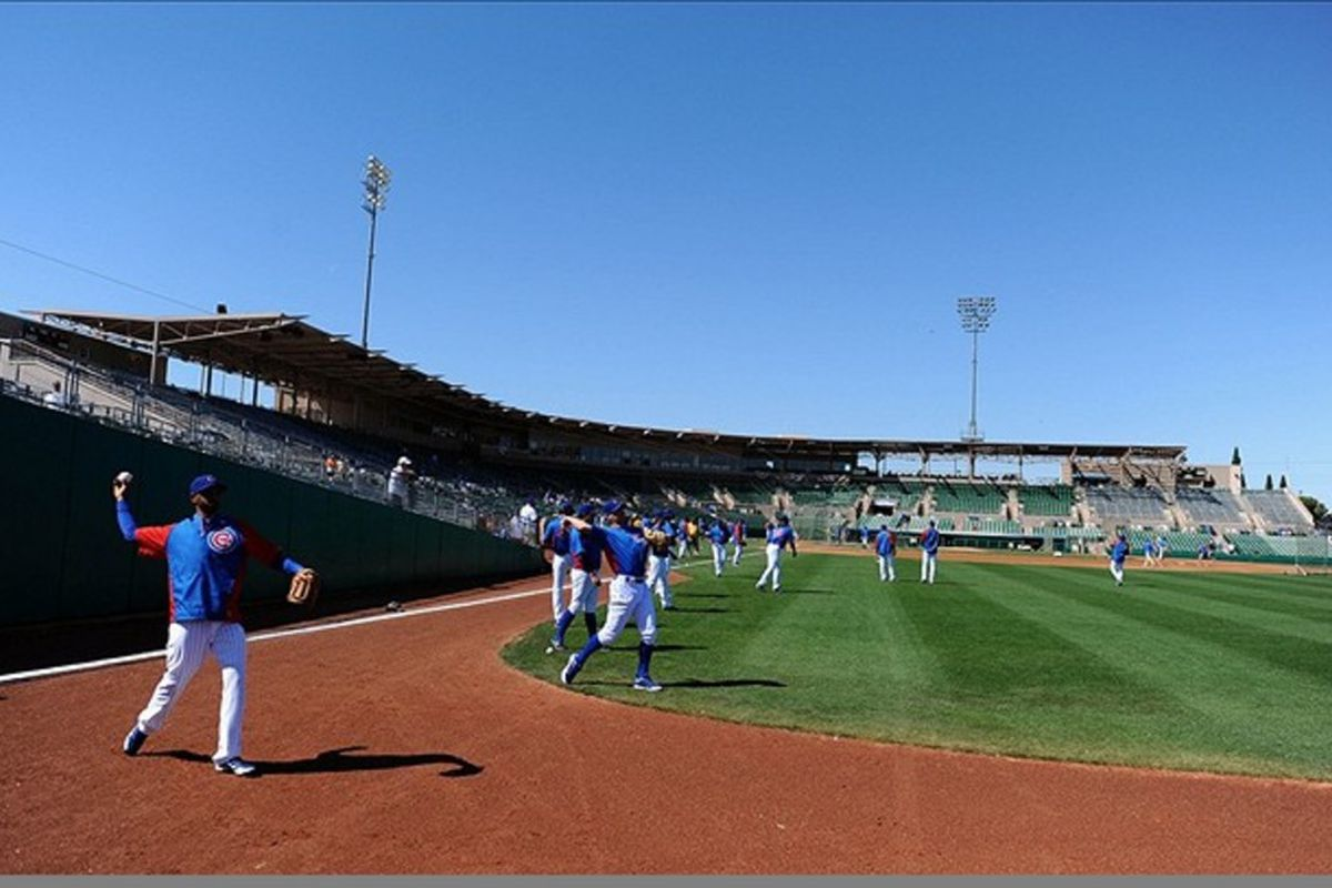 Mesa, AZ, USA; Chicago Cubs players warm up along the right field line at Hohokam Stadium. Credit: Christopher Hanewinckel-US PRESSWIRE
