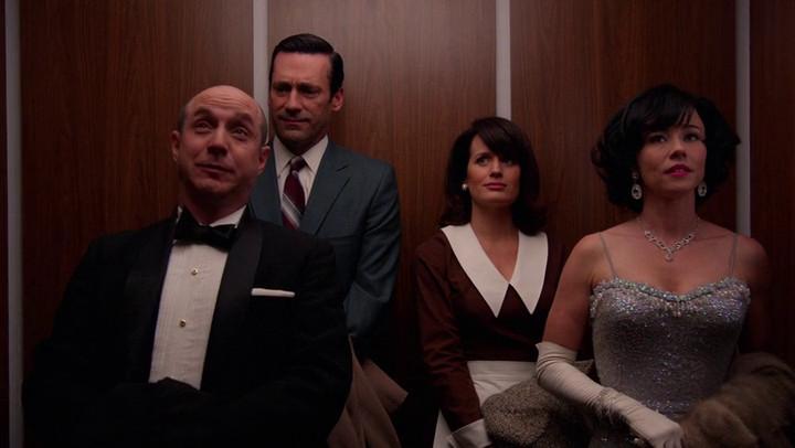 An awkward elevator rides transpires on Mad Men.
