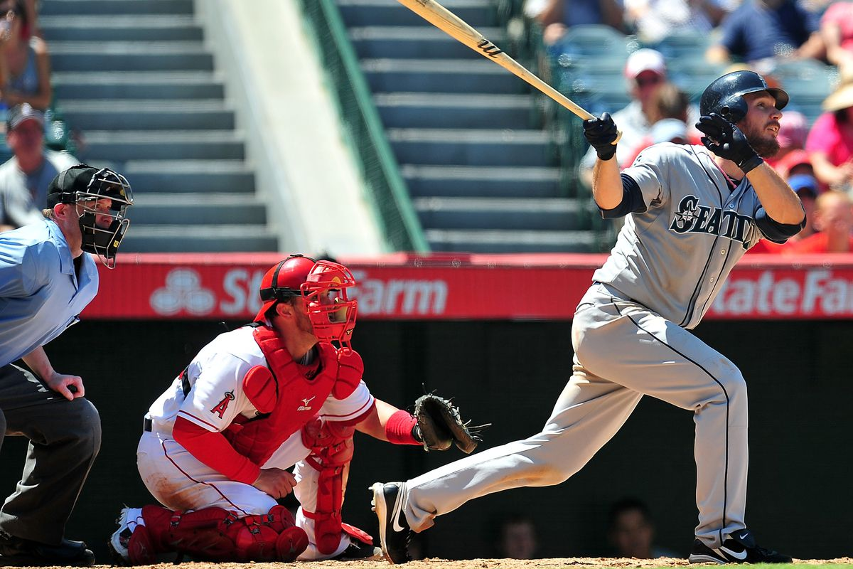 August 12, 2012; Anaheim, CA, USA; Seattle Mariners catcher John Jaso (27) hits a single in the sixth inning against the Los Angeles Angels at Angel Stadium. Mandatory Credit: Gary A. Vasquez-US PRESSWIRE