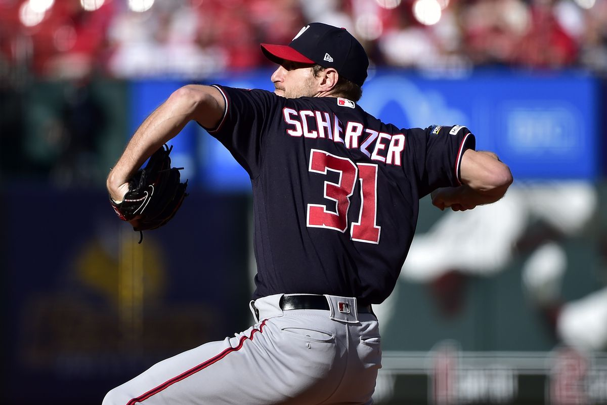 Washington Nationals starting pitcher Max Scherzer throws against the St. Louis Cardinals during the first inning in game two of the 2019 NLCS playoff baseball series at Busch Stadium.
