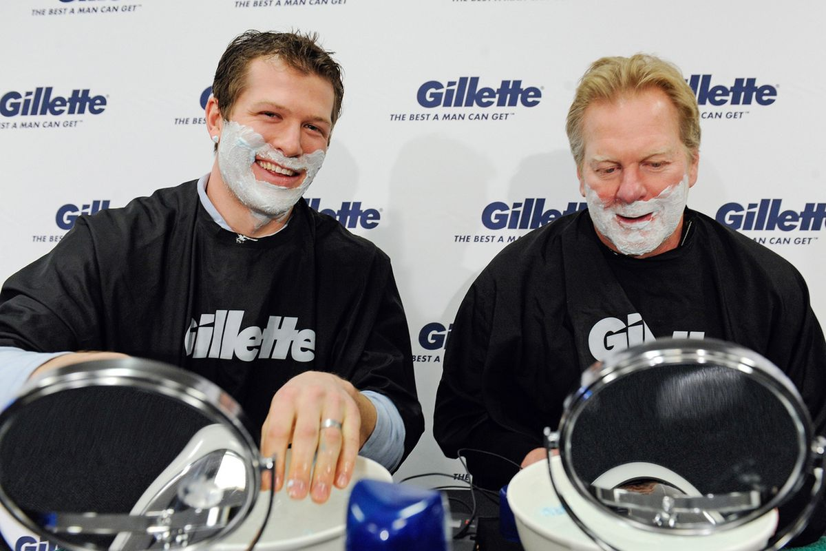 Ryan Suter, left, Gillette's U.S. athlete ambassador for the 2014 Olympic Winter Games, participates in a ceremonial shave and send-off to Sochi with his father, 1980 Olympic Gold medalist Bob Suter on Wednesday, Feb. 5, 2014 in St. Paul, Minn