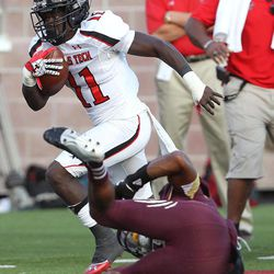 Texas Tech's Jakeem Grant works past Texas State's Xavier Daniels during their NCAA college football game in San Marcos, Texas, Saturday, Sept. 8, 2012.