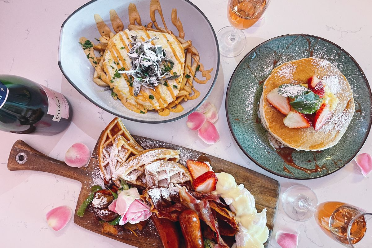 Table set with champagne and brunch dishes at Bubble & Brunch