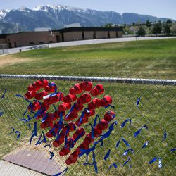 A sign outside Brookwood Elementary shows support for Myles Rackley, a student at the school who was injured in Tuesday's shooting near the school on Alta Canyon Drive in Sandy on Wednesday, June 7, 2017.